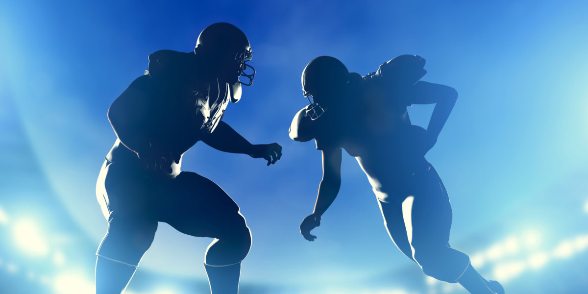 American football players in game, quarterback running. Game