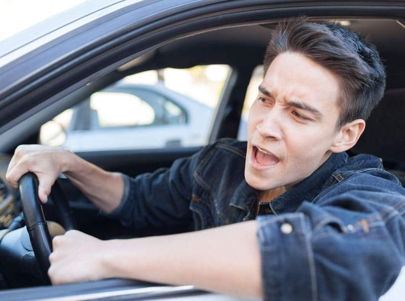 Tips to Control Road Rage an angry driver behind the wheel of a car