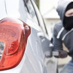 Commonly Stolen Cars (and How to Protect Yours) man trying to steal a car