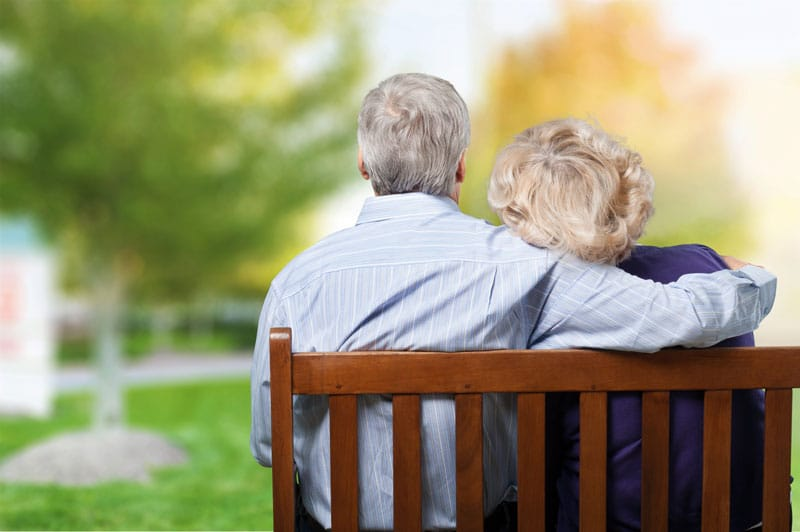 What to Do When Your Term Life Insurance Policy Runs Out an elderly couple on a bench