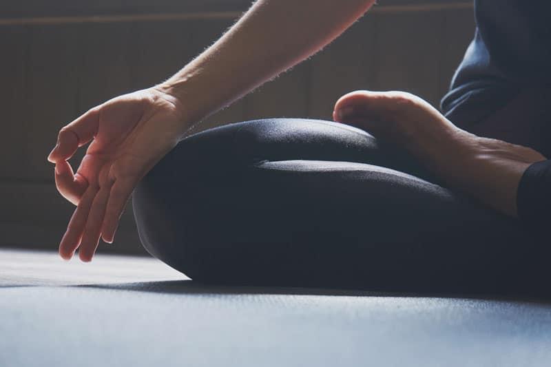 someone practicing yoga