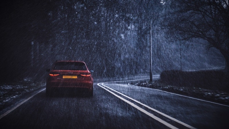 a car driving in the dark |Five Useful Tips for Driving Safely in the Dark