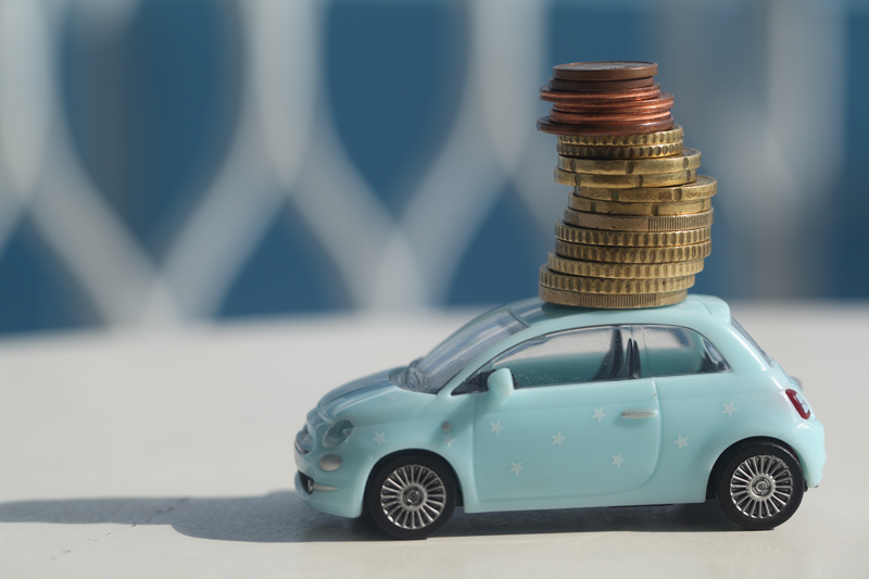 coins on top of a car figure