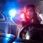 a woman pulled over by police in car