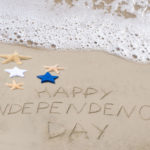 happy independence day in sand